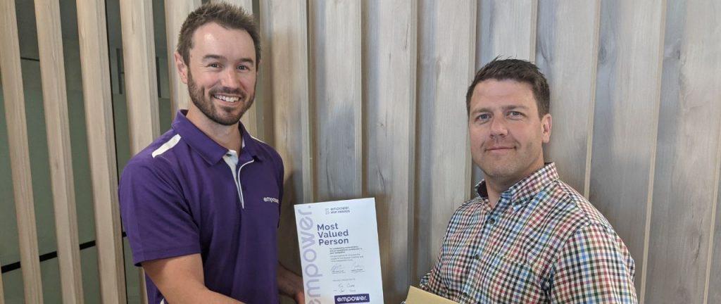 Tim Cooper receiving Jan MVP Award from Empower CEO Adam Gilroy-Smith
