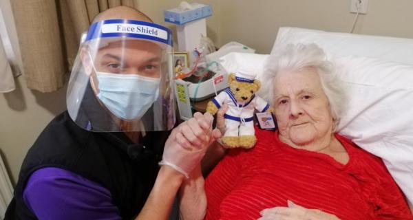 Kathleen Mytton receiving a Legacy Week bear