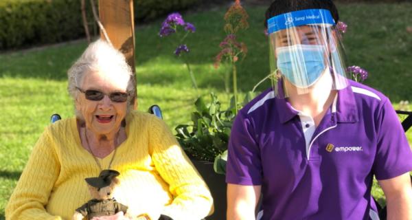 Miriam Jagger receiving a 2020 Legacy Week bear