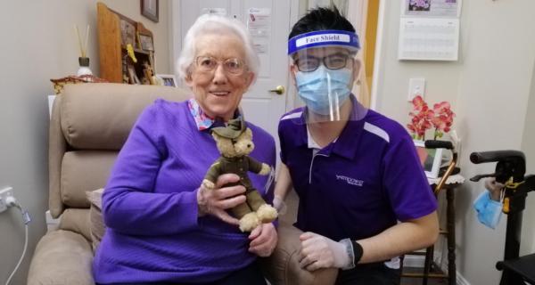 Patricia Adams receiving a Legacy Week bear