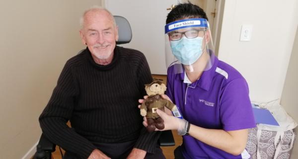 Roger McKeown receiving a Legacy Week bear