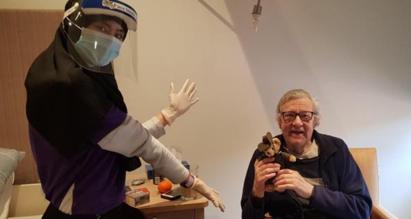 Tony Pauley receiving a Legacy Week bear