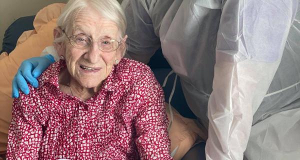 Betty Moylan receiving her legacy week bear