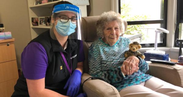 Dorothy Moore receiving her 2020 Legacy Week bear